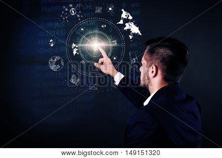 Businessman working with virtual touchscreen. Virtual button on display. Technology concept.