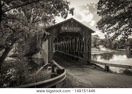 Historical Wooden Covered Bridge. The historical Fallasburg covered bridge remains open to auto traffic and is located about 30 minutes from the city of Grand Rapids in Lowell Michigan.