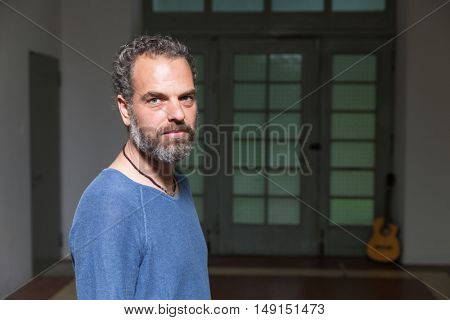 Portrait of a musician, industrial location