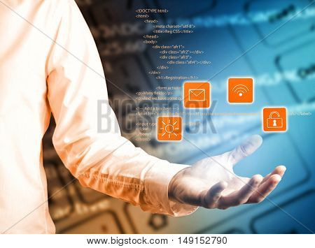 Man working with virtual screen. Male hand with virtual icons. Programming code on keyboard background. Modern technology concept.