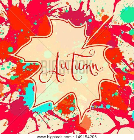 Word Autumn hand written over maple leaf on a bright orange and red artistic paint splatter background. Contemporary calligraphy. Square format Autumn card.
