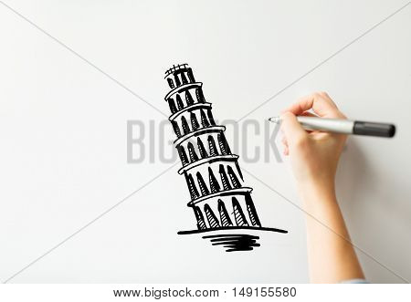 people, travel, tourism, graphic arts and architecture concept - close up of hand with marker drawing leaning tower of pisa sketch on white board or paper
