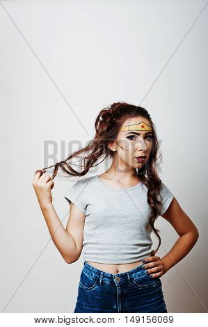 Studio Portrait Of Girl With Asian Appearance And Bright Make Up With Red Star On Forehead