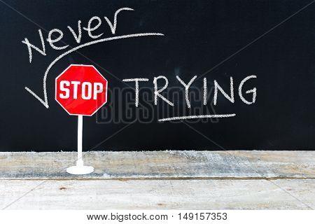 Never Stop Trying Message Written On Chalkboard