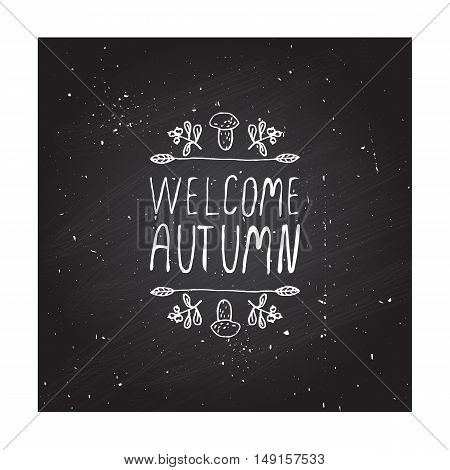 Hand-sketched typographic element with mushroom, berries and text on chalkboard background. Welcome autumn
