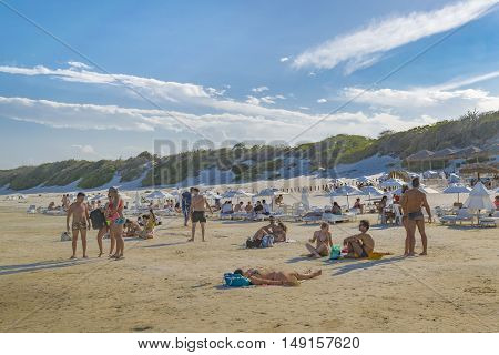 JERICOACOARA, BRAZIL, DECEMBER - 2015 - People sunbathing at Lagoa do Paraiso beach in Jericoacoara Brazil
