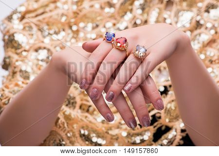 Hands with jewellery rings in fashion concept
