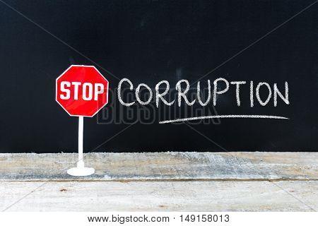 Stop Corruption Message Written On Chalkboard