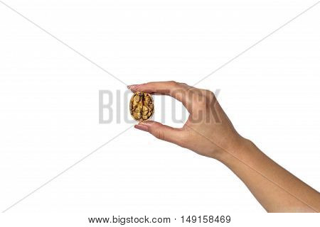 One hand braking a walnuts in a white background.