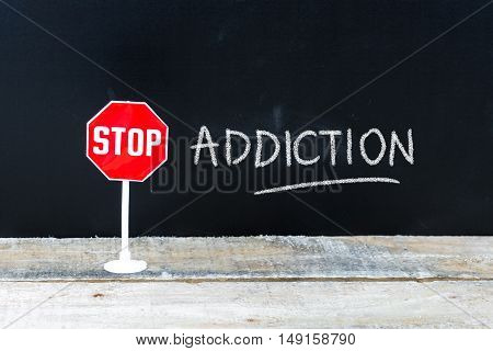 Stop Addiction Message Written On Chalkboard