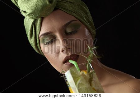 Woman In Green Turban With A Cocktail