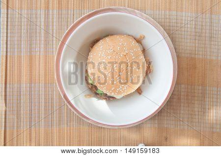 Top view bbq hamburger on mat background