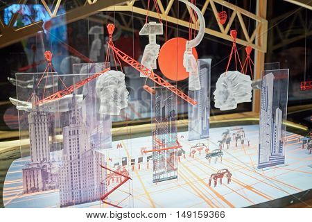 MOSCOW, RUSSIA - DEC 20, 2014: Glass art symbols of USSR in pavilion Space at exhibition Miracle Mechanics at VDNKH. Exhibition presents objects created for the opening of 22-d Olympic Winter Games.