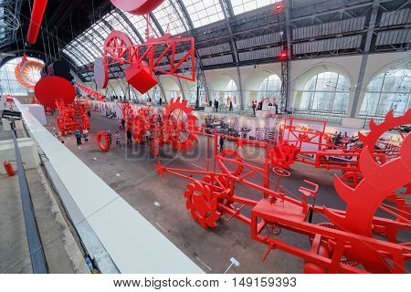 MOSCOW, RUSSIA - DEC 20, 2014: Large red machines in pavilion Space at exhibition Miracle Mechanics at VDNKH. Exhibition presents objects created for the opening of 22-d Olympic Winter Games.