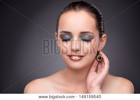 Beautiful woman showing off her jewellery in fashion concept