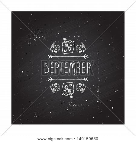 Hand-sketched typographic element with apple, apple cider and text on chalkboard background. September