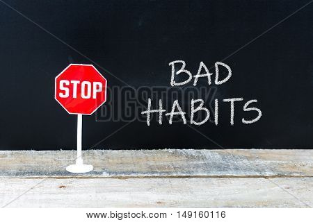 Stop Bad Habits Message Written On Chalkboard