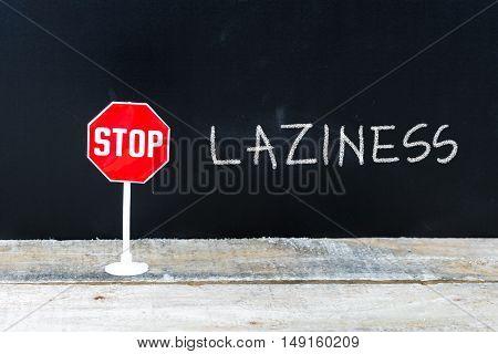 Stop Laziness Message Written On Chalkboard