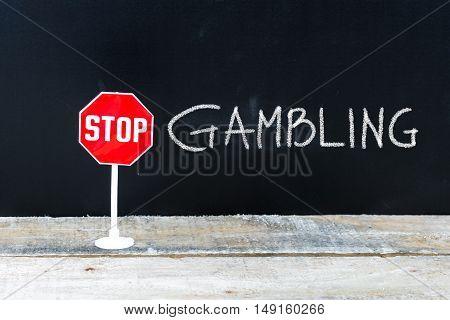 Stop Gambling Message Written On Chalkboard