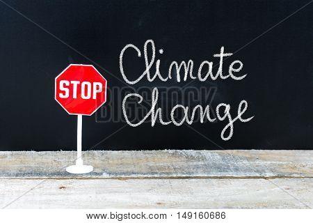 Stop Climate Change Message Written On Chalkboard