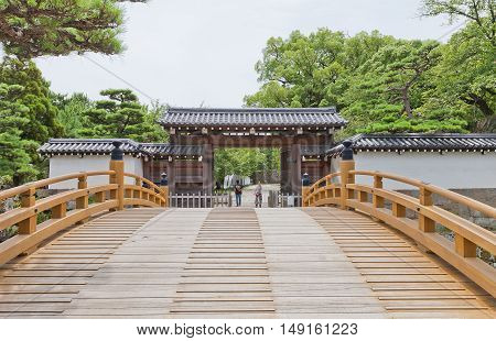 WAKAYAMA JAPAN - JULY 24 2016: Ichinohashi Bridge and Otemon (Main) Gate of Wakayama castle Japan. Gate was erected in 1585 collapsed in 1909 reconstructed in 1982