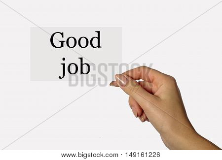 Beautiful hand of a young girl holding a card on a white background with the words Good job