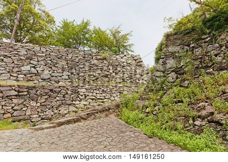Stone walls (ishigaki) of Wakayama castle Japan. Castle was erected in 1585 bombed out in 1945 reconstructed in 1958
