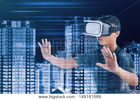 Technologies of the future concept. Boy wearing virtual reality glasses