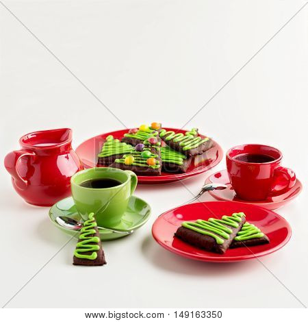 Breakfast. Coffee with honey-ginger cookies in the shape of a Christmas tree decorated with colorful jelly beans.