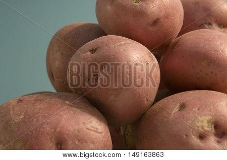 Close-up shot of red potatoes in a pile
