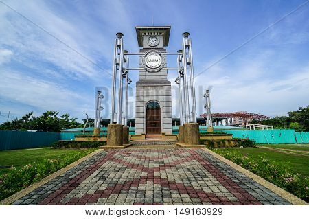 Labuan,Malaysia-Sept 27,2016:View of Labuan Clock Tower located at Sea Sport Complex,Labuan island,Malaysia.It was the only structure in Labuan Town that survived the Allied bombardment of 1945.