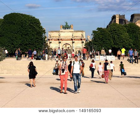 FRANCE. PARIS - JUNE 24, 2015: Tourists on the background of the Arch Roundabout. The Arc de Triomphe at the Carousel Square - a monument in the Empire style.