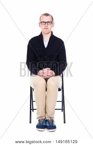 Young Man Student Or Office Worker Sitting On Office Chair Isolated On White