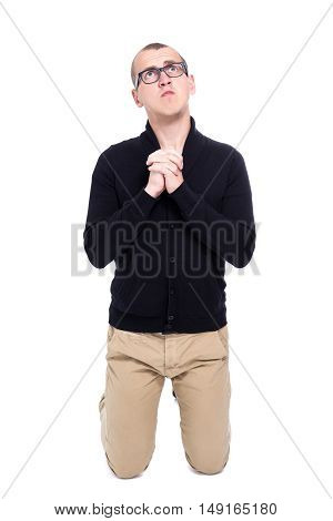 Portrait Of Funny Young Man Praying Isolated On White