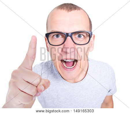 Portrait Of Angry Young Man In Glasses With Braces On Teeth Screaming Isolated On White