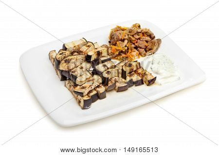 Platter of grilled eggplant with tzatziki sauce and meat