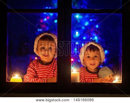 Two Seeet Boys, Sitting On A Window, Looking Outdoor, Wintertime, Waiting Impatiently For Christmas