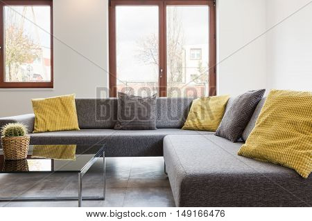 Modern living room- grey corner settee with yellow pillows