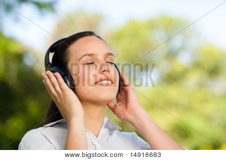 Beautiful Woman Listening To Music