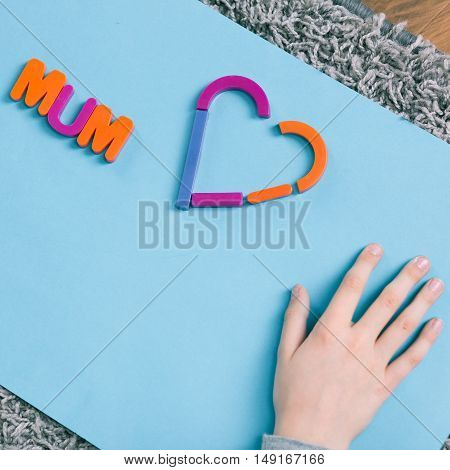 Shot of a paper with a word 'mum' and heart on it