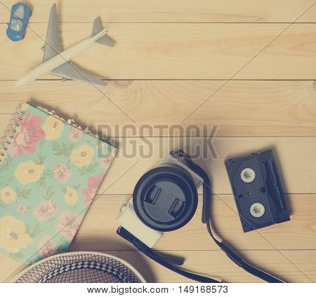 Travel blogger equipment on wooden table in vintage color