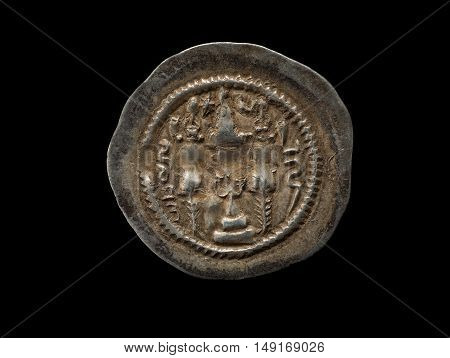 Ancient Silver Sassanian Coin Isolated On Black
