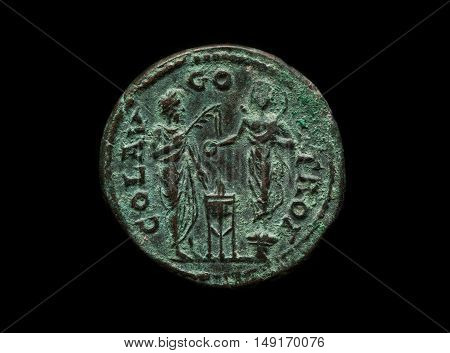 Round Ancient Copper Coin With Two Figures On It