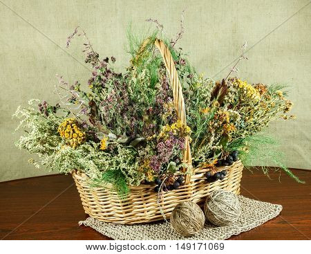 Basket with healing herbs. Dried grass for use in alternative medicine spa herbal cosmetics herbal medicine preparing infusions decoctions tinctures powders ointments butter tea bath.