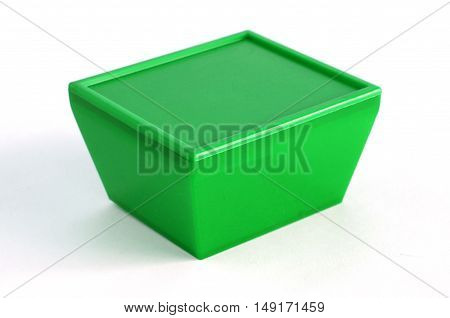 Green plastic box on a white background