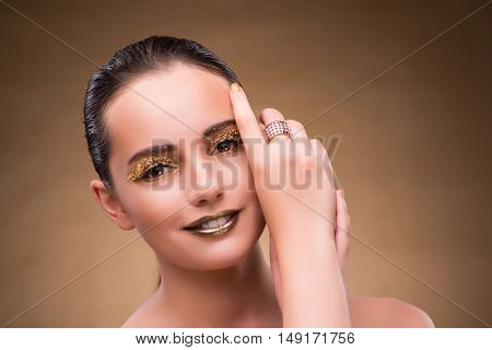 Woman with golden ring in beauty concept