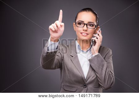 Businesswoman pressing virtual buttons in business concept