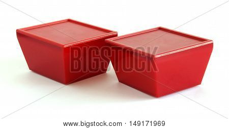 Red plastic boxes on a white background
