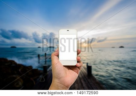 Mobile smart phone behind the harbor is beautiful.