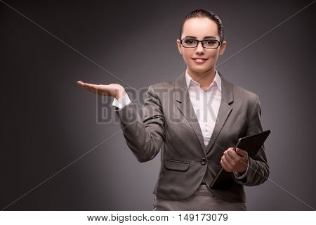 Young businesswoman pressing virtual button